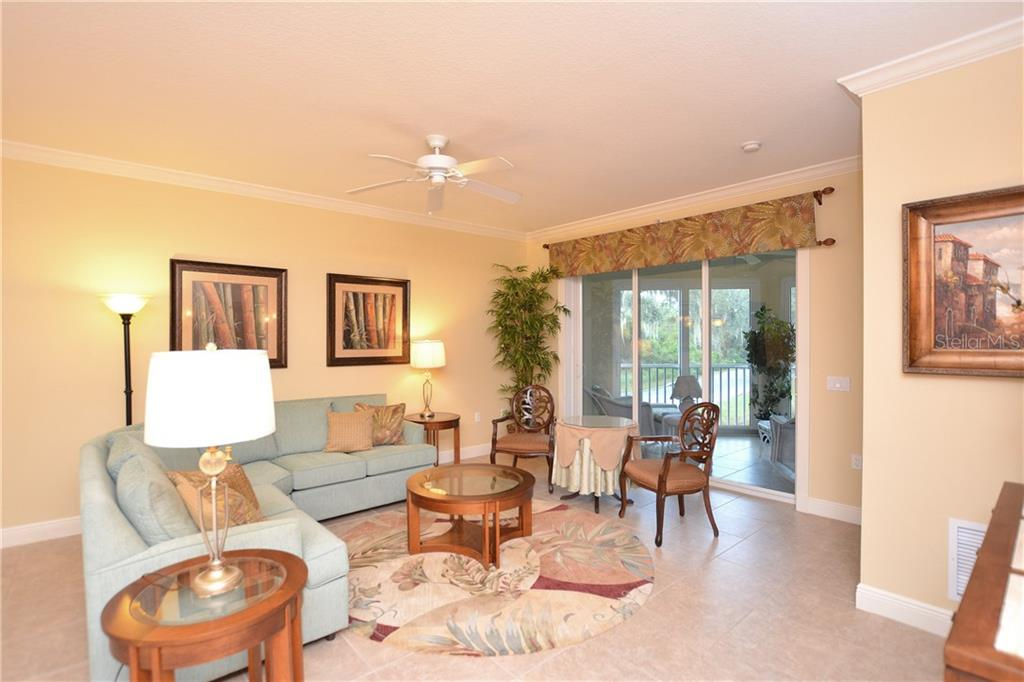 Open the triple sliders and expand your living space. - Condo for sale at 5304 Manorwood Dr #2b, Sarasota, FL 34235 - MLS Number is A4448585