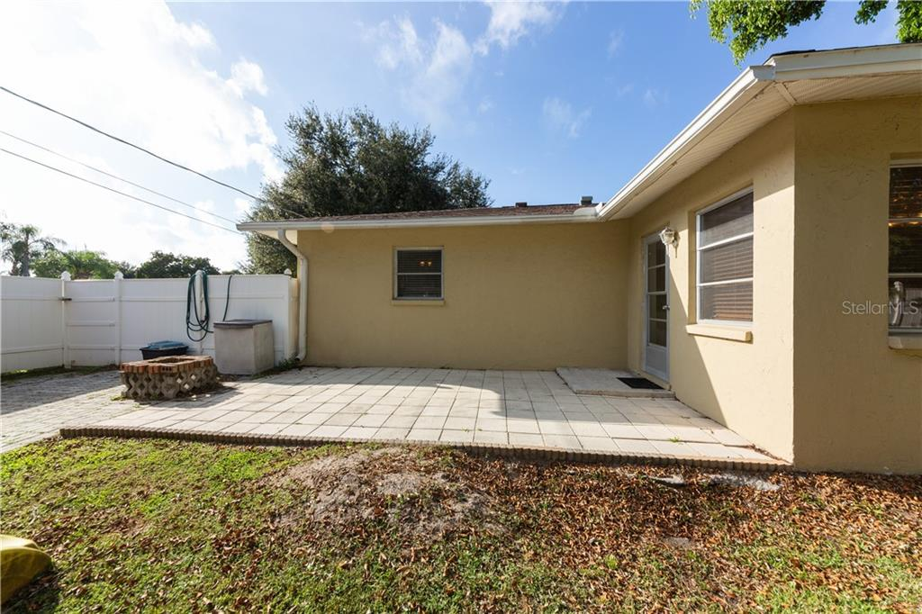 Privacy fenced backyard with patio and fire pit - Duplex/Triplex for sale at 311 Coronado Rd, Venice, FL 34293 - MLS Number is A4449208