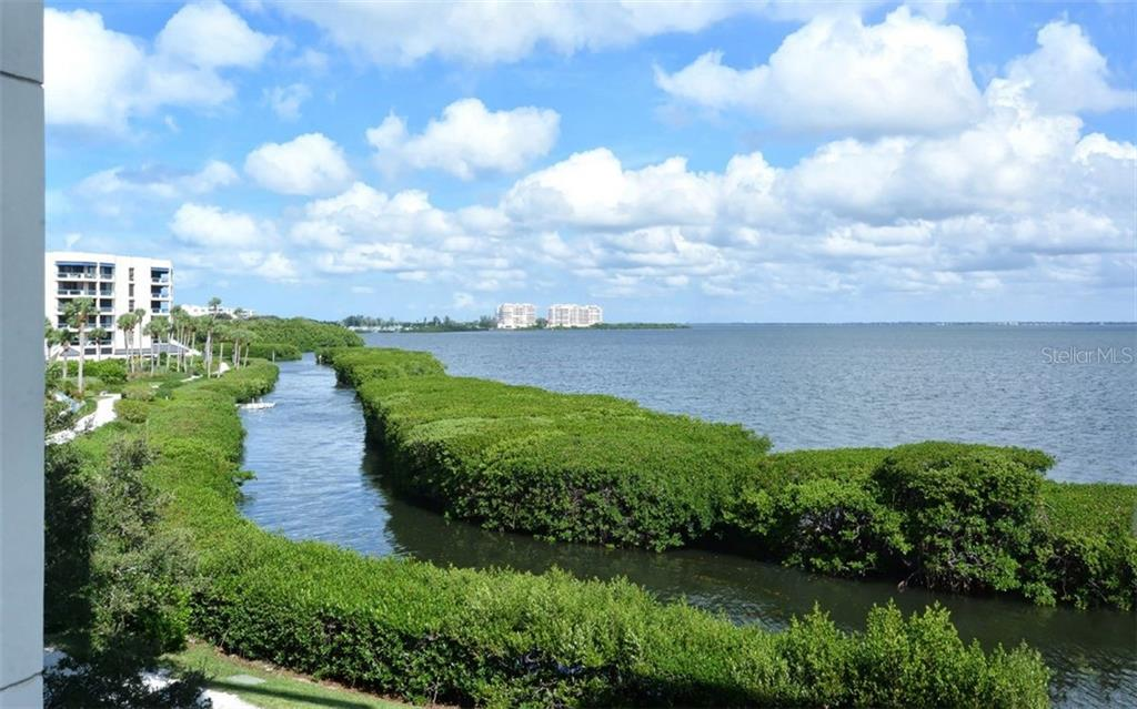 View from living room of waterway & bay - Condo for sale at 2020 Harbourside Dr #422, Longboat Key, FL 34228 - MLS Number is A4449537