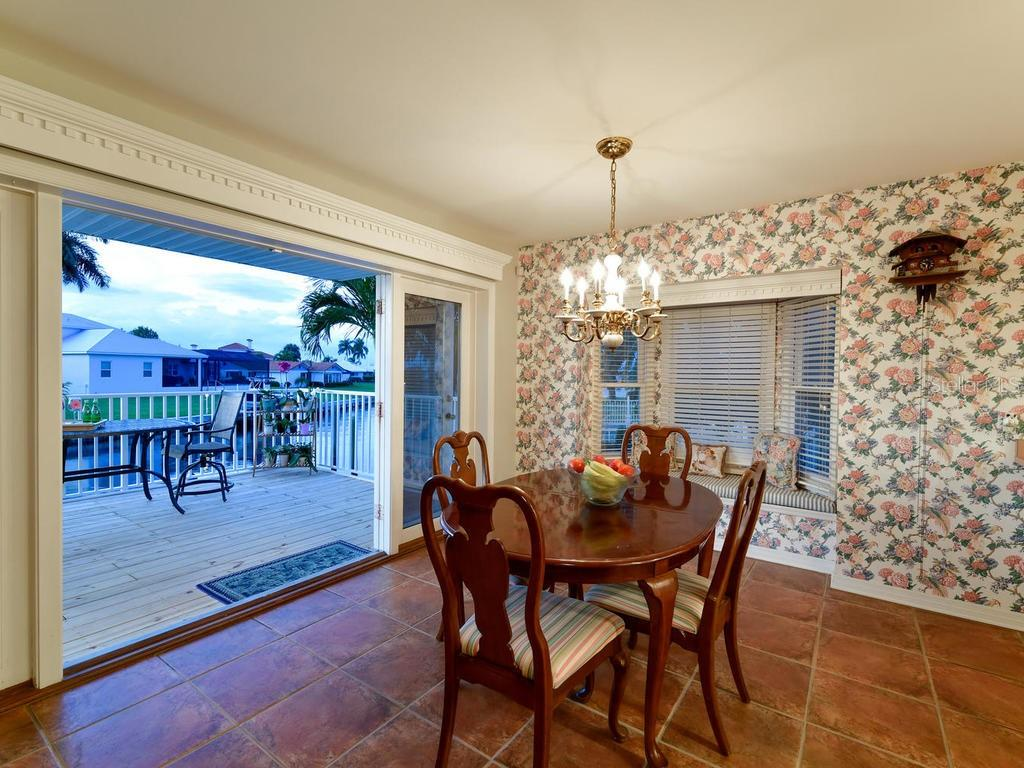Breakfast Nook overlooking the salt water canal - Single Family Home for sale at 2008 72nd St Nw, Bradenton, FL 34209 - MLS Number is A4450238