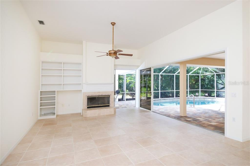 Virtually staged - Family room opens directly to the pool - Single Family Home for sale at 6620 Hunter Combe Xing, University Park, FL 34201 - MLS Number is A4450282