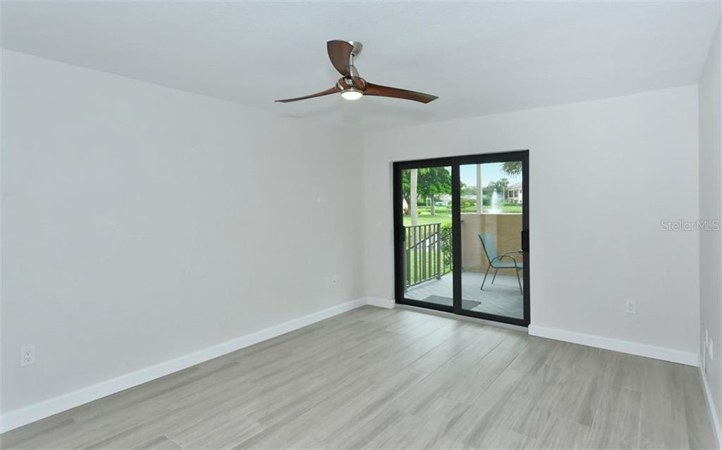 master bedroom - Condo for sale at 5217 Heron Way #102, Sarasota, FL 34231 - MLS Number is A4451295