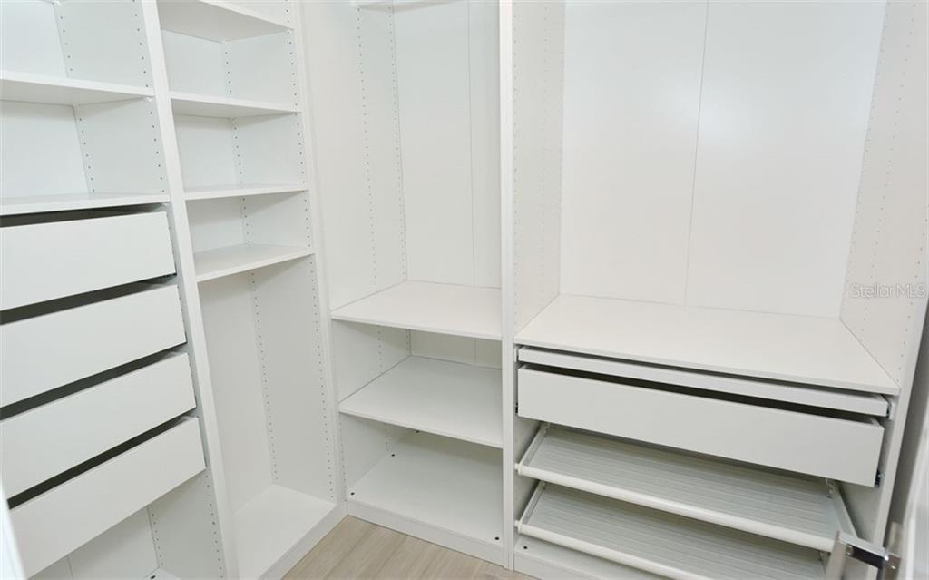 walk in closet - Condo for sale at 5217 Heron Way #102, Sarasota, FL 34231 - MLS Number is A4451295