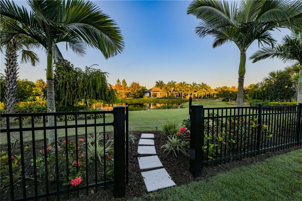 Privacy fence leading to extended backyard and water access to interlinking lakes. - Single Family Home for sale at 16119 Baycross Dr, Lakewood Ranch, FL 34202 - MLS Number is A4452632