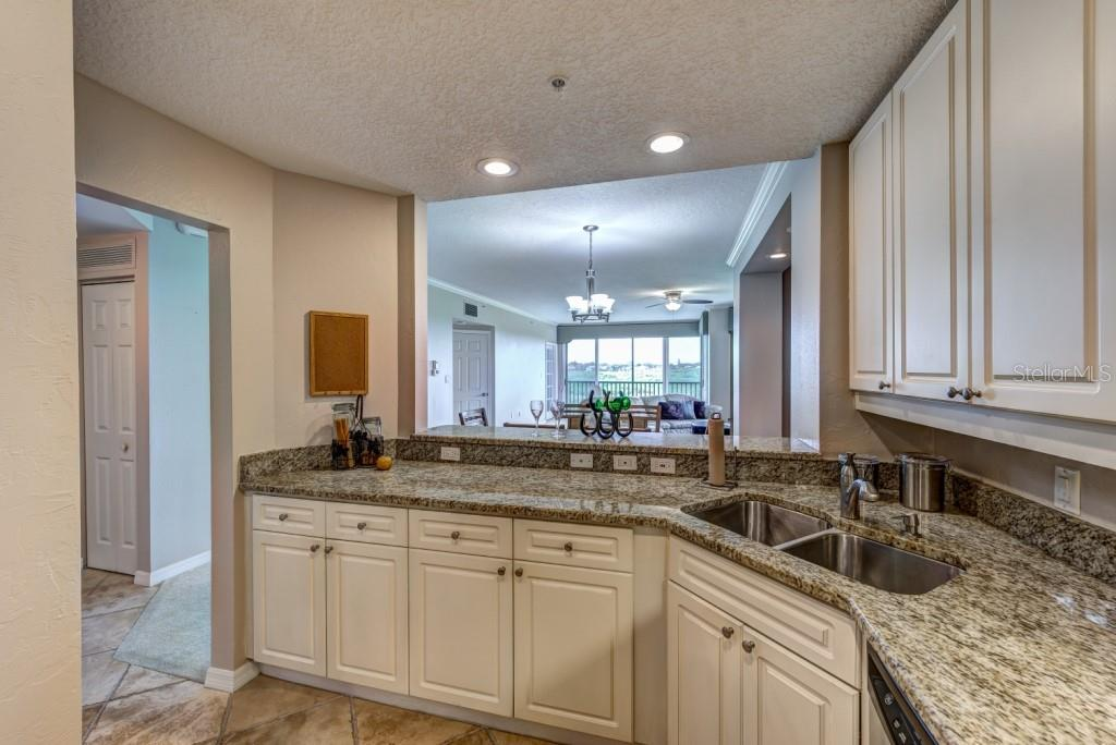 The chef of the family will be inspired to create culinary masterpieces with views of the outdoors through the large pass thorough. - Condo for sale at 5420 Eagles Point Cir #204, Sarasota, FL 34231 - MLS Number is A4454318