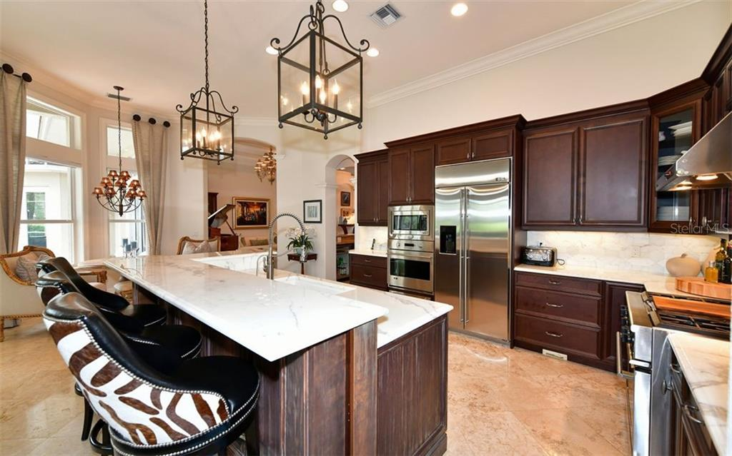Kitchen - Single Family Home for sale at 574 N Macewen Dr, Osprey, FL 34229 - MLS Number is A4455085