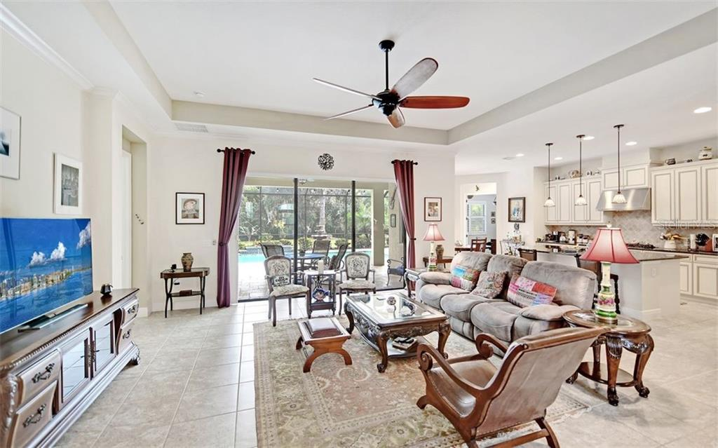 Easy access kitchen with eat in space and breakfast bar! - Single Family Home for sale at 8260 Larkspur Cir, Sarasota, FL 34241 - MLS Number is A4455087