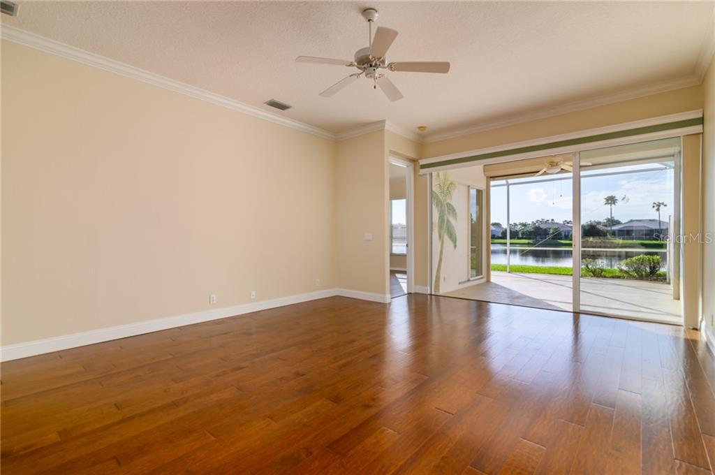 Living Room - Villa for sale at 4560 Samoset Dr, Sarasota, FL 34241 - MLS Number is A4455487