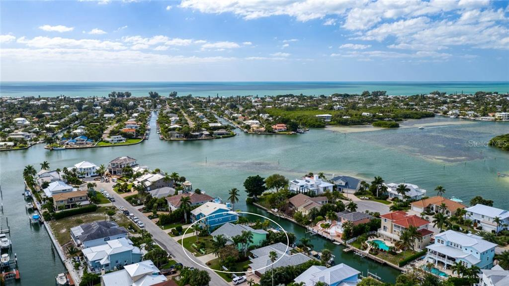 Aerial view of Bimini Bay to the Gulf of Mexico in North Point Harbour in Key Royale - Single Family Home for sale at 609 N Point Dr, Holmes Beach, FL 34217 - MLS Number is A4455659