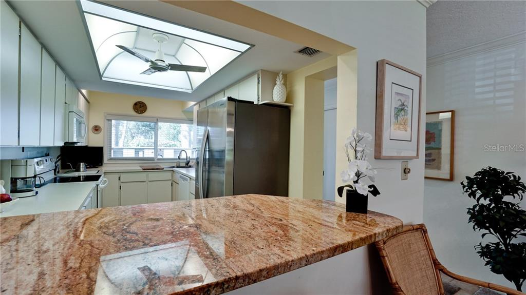 HANDSOME GRANITE COUNTER, LARGE STAINLESS DOUBLE DOOR FRIDGE, LOTS OF KITCHEN CABINETS. BRAND NEW HURRICANE & SOUND PROOF WINDOWS INSTALLED IN KITCHEN, FRONT ROOM & LIVING ROOM. - Condo for sale at 6700 Gulf Of Mexico Dr #116, Longboat Key, FL 34228 - MLS Number is A4456442