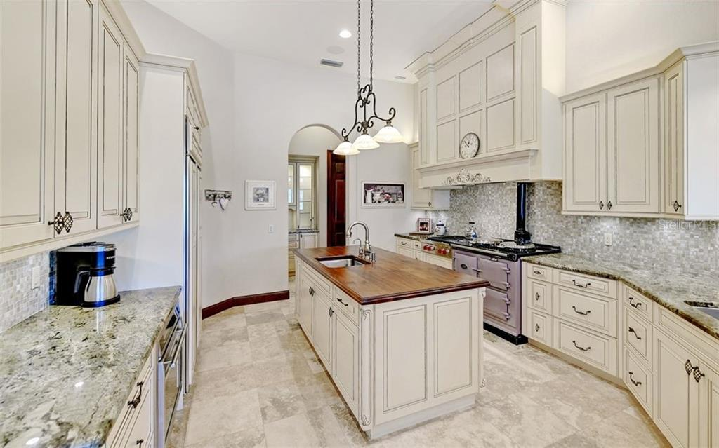 Kitchen renovated in 2012 with AGA stove, plus separate Wolf cook top and oven, custom hood. - Single Family Home for sale at 562 N Macewen Dr, Osprey, FL 34229 - MLS Number is A4456557