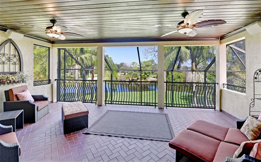 Fabulous balcony off the bonus room... overlooking the lake and golf course! Gas fireplace keeps it cozy! - Single Family Home for sale at 562 N Macewen Dr, Osprey, FL 34229 - MLS Number is A4456557