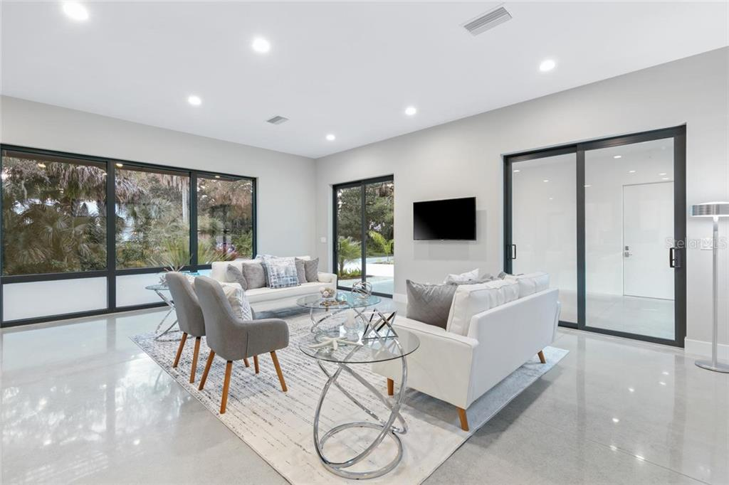 Room for everyone to be together with stunning polished concrete flooring. - Single Family Home for sale at 2301 Hyde Park St, Sarasota, FL 34239 - MLS Number is A4456649
