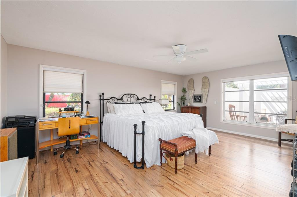 Huge guest room, as large as master bedroom, with it's own en suite bathroom.  Huge windows provide natural light and a view to the courtyard area. - Single Family Home for sale at 4557 Camino Real, Sarasota, FL 34231 - MLS Number is A4457740