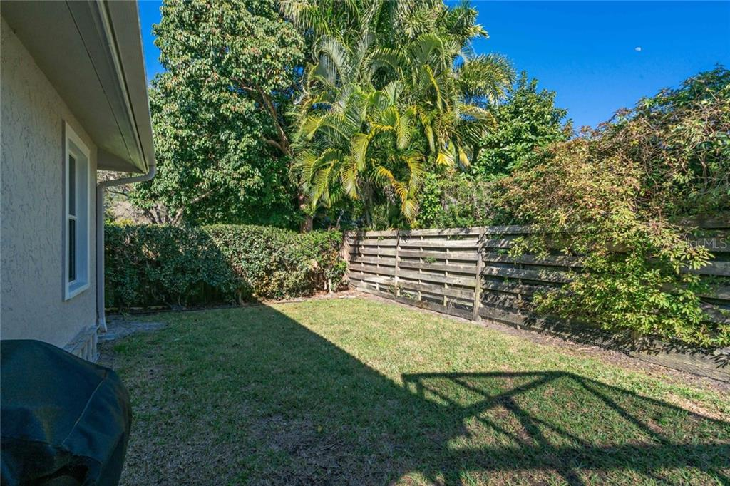 Fenced in backyard for the furry friends and enough room for a play set for the little ones. - Single Family Home for sale at 4557 Camino Real, Sarasota, FL 34231 - MLS Number is A4457740