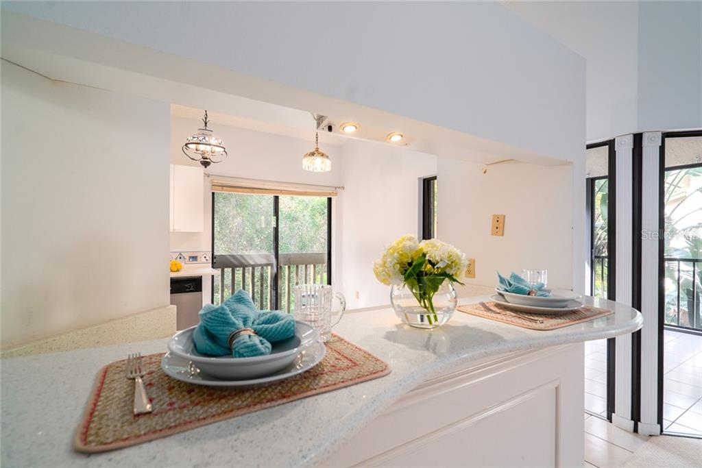 Breakfast bar - Quartz counter - Condo for sale at 1668 Starling Dr #204, Sarasota, FL 34231 - MLS Number is A4458491