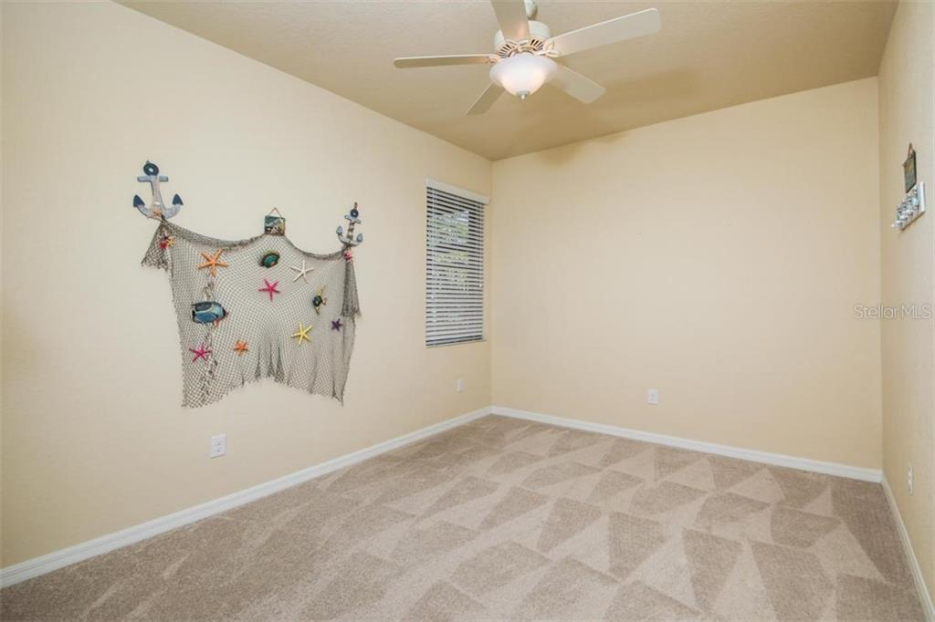 Single Family Home for sale at 214 Whispering Palms Ln, Bradenton, FL 34212 - MLS Number is A4458542