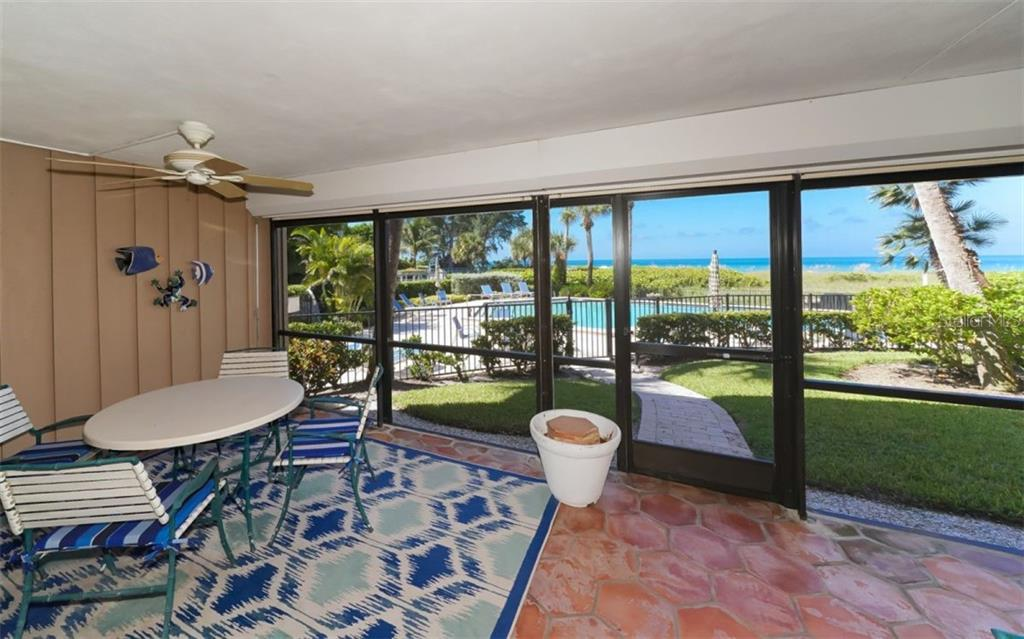 Walk out of the Lanai to pool and path to beach and BBQ area - Condo for sale at 5635 Gulf Of Mexico Dr #102, Longboat Key, FL 34228 - MLS Number is A4458745