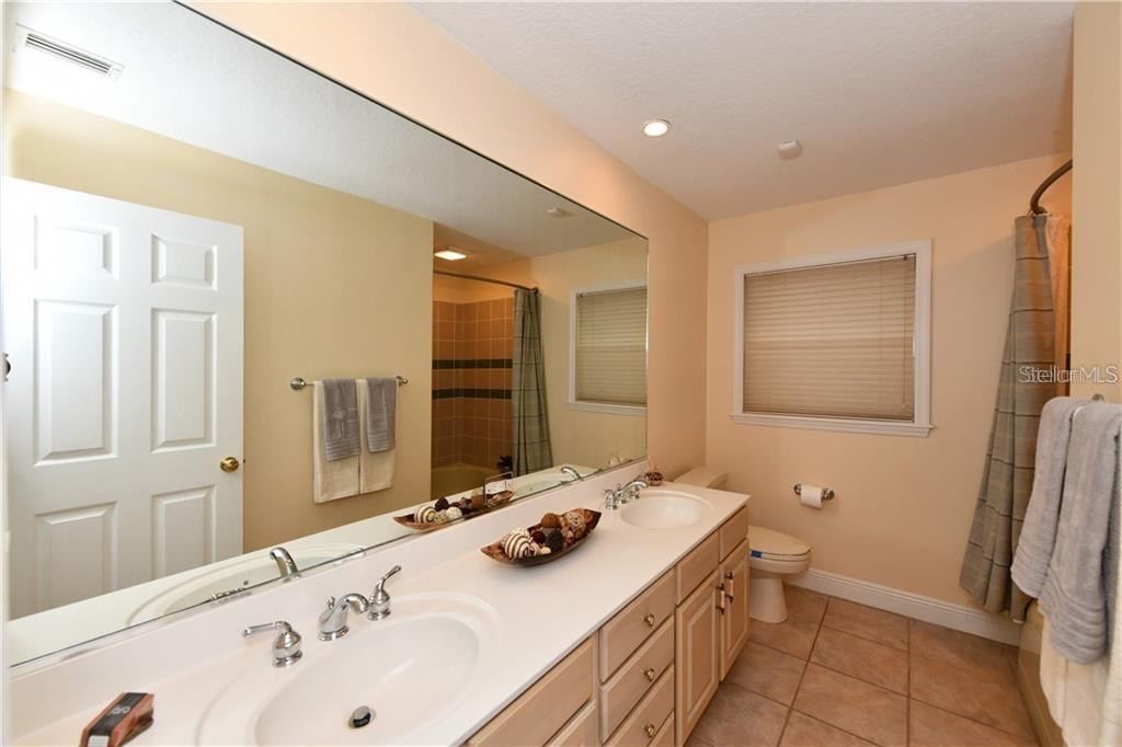 Guest bathroom. Double sinks. - Single Family Home for sale at 1332 Quail Dr, Sarasota, FL 34231 - MLS Number is A4458756