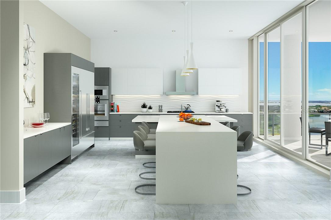The spacious kitchen with double island, Italian cabinetry, Gaggenau appliances, & gas cooking is the place for a leisurely morning coffee or a sumptuous dinner by the bay. - Condo for sale at 605 S Gulfstream Ave #Ph18, Sarasota, FL 34236 - MLS Number is A4458982