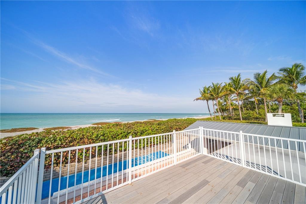 Upper level sun deck off Master bedroom - Single Family Home for sale at 8334 Sanderling Rd, Sarasota, FL 34242 - MLS Number is A4461606