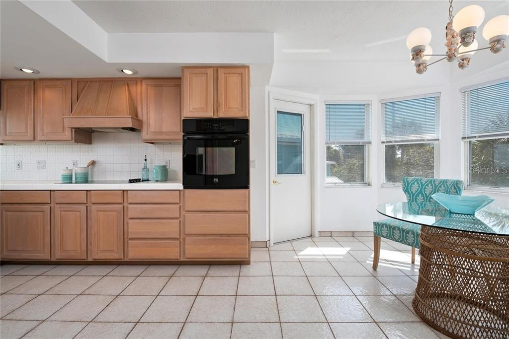 Kitchen and breakfast nook - Single Family Home for sale at 710 S Bay Blvd, Anna Maria, FL 34216 - MLS Number is A4461640
