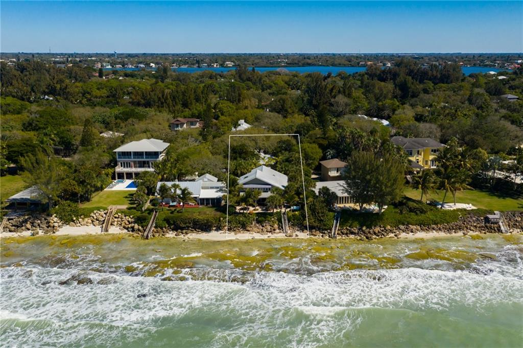 Aerial w/ views toward IntraCoastal Waterway - Single Family Home for sale at 7340 Point Of Rocks Rd, Sarasota, FL 34242 - MLS Number is A4461841