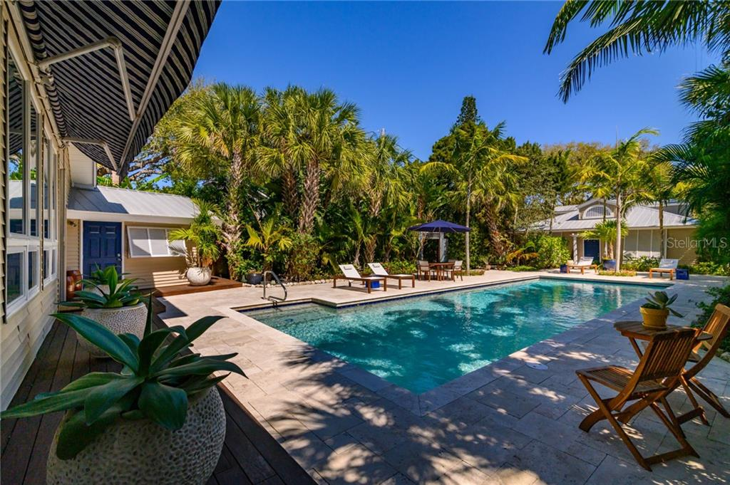 Courtyard from SW corner by pool side suite - Single Family Home for sale at 7340 Point Of Rocks Rd, Sarasota, FL 34242 - MLS Number is A4461841