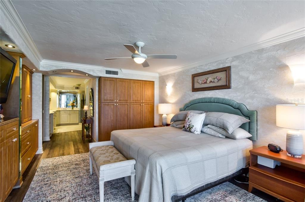 The oversized master bedroom suite includes plenty of storage and crown moulding. - Condo for sale at 5880 Midnight Pass Rd #911, Sarasota, FL 34242 - MLS Number is A4462559