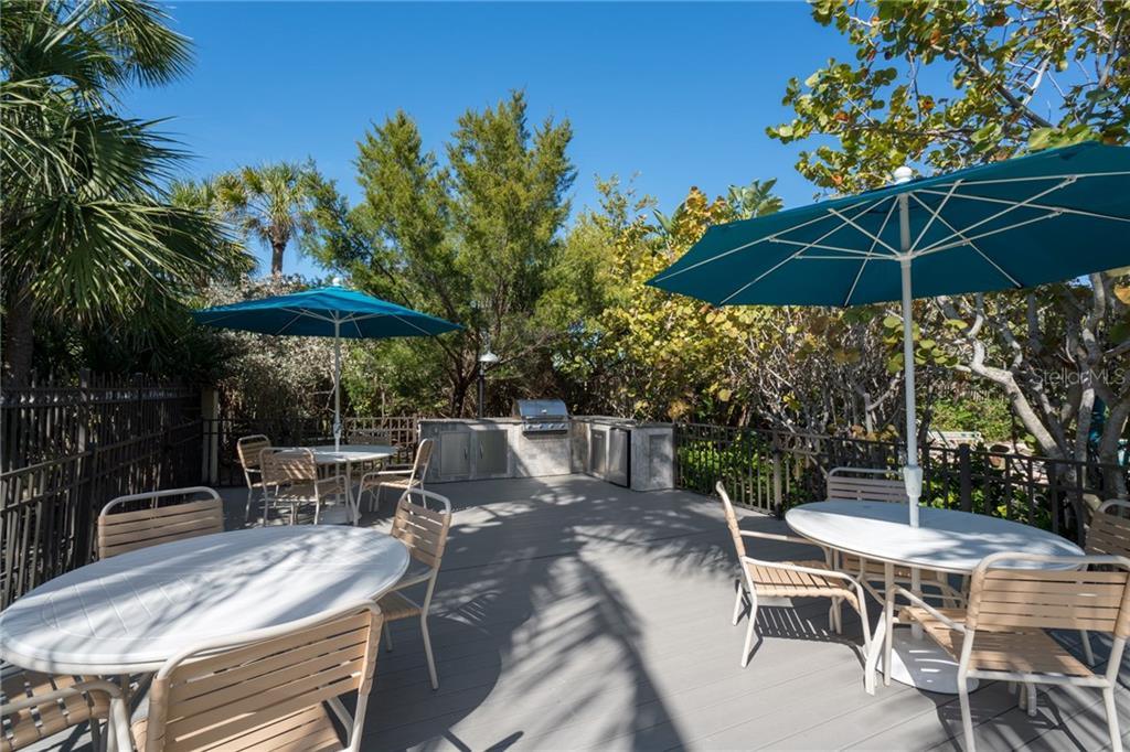 This shaded deck provides gas gill #2 and tables for private dining or entertaining - Condo for sale at 5880 Midnight Pass Rd #911, Sarasota, FL 34242 - MLS Number is A4462559