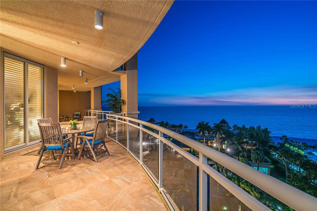 twilight on expansive terrace - Condo for sale at 1300 Benjamin Franklin Dr #805, Sarasota, FL 34236 - MLS Number is A4462621
