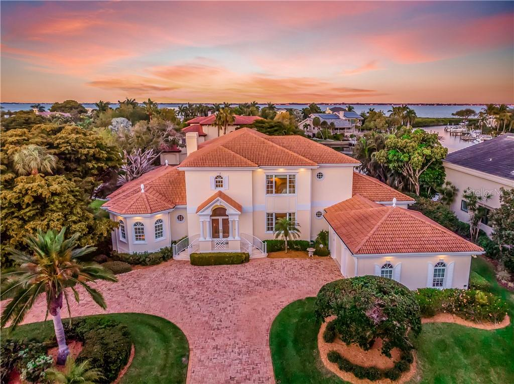 Block construction, brick pavered circular drive, elegant lines and and over-sized side entry garage add beauty and grace to this impressive Bay Isles home. - Single Family Home for sale at 1590 Harbor Sound Dr, Longboat Key, FL 34228 - MLS Number is A4463437