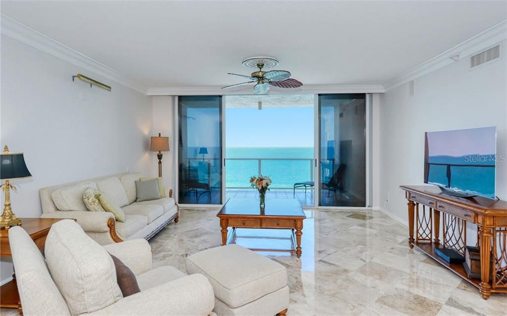 Is it tranquility you are looking for? This view never gets old and changes daily!  Settle in and embrace the privacy and amenities at L'Elegance on Lido Beach. - Condo for sale at 1800 Benjamin Franklin Dr #B1009, Sarasota, FL 34236 - MLS Number is A4463964