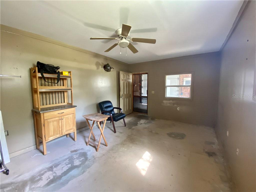 View inside the air conditioned work space to the garage. - Single Family Home for sale at 4300 Eastern Pkwy, Sarasota, FL 34233 - MLS Number is A4464200