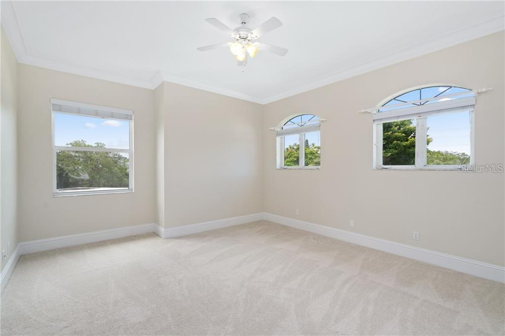 Single Family Home for sale at 7433 Midnight Pass Rd, Sarasota, FL 34242 - MLS Number is A4464297
