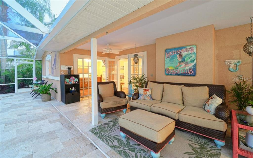 SOFT TRAVERTINE TILE THROUGHOUT THE WHOLE SCREENED IN PATIO & POOL - Single Family Home for sale at 3 Winslow Pl, Longboat Key, FL 34228 - MLS Number is A4464990