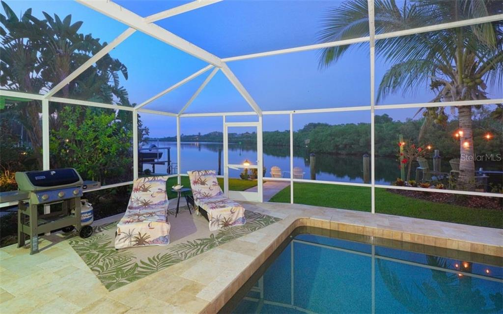 ENJOY AN EVENING SWIM IN YOUR ELONGATED PEBBLE TEC POOL! - Single Family Home for sale at 3 Winslow Pl, Longboat Key, FL 34228 - MLS Number is A4464990