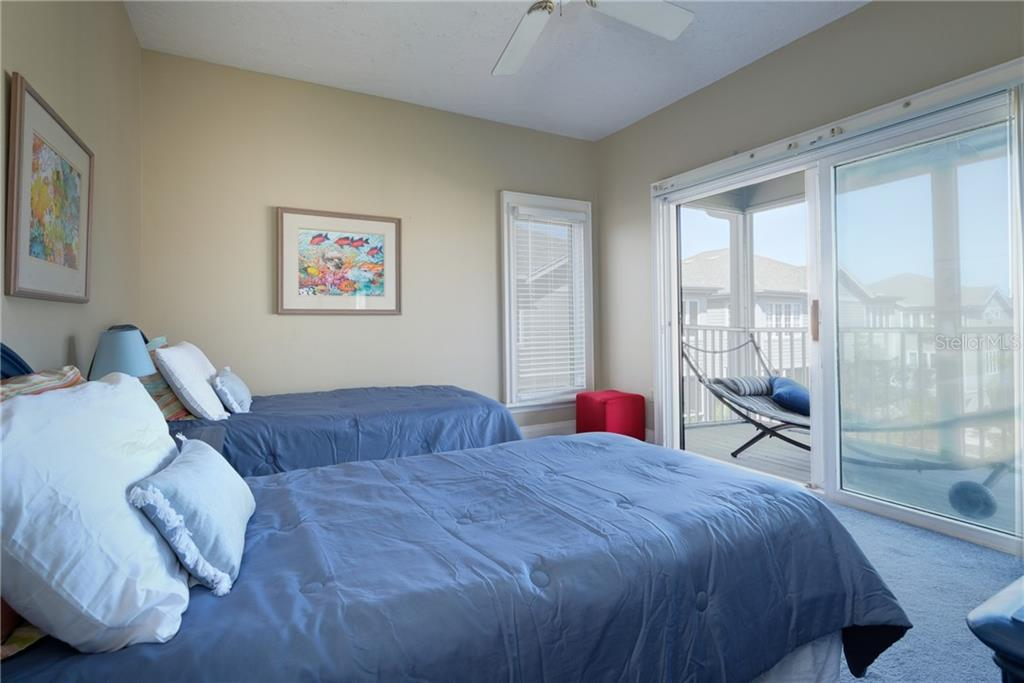 Screened deck off twin guest room. - Condo for sale at 515 Forest Way, Longboat Key, FL 34228 - MLS Number is A4465231