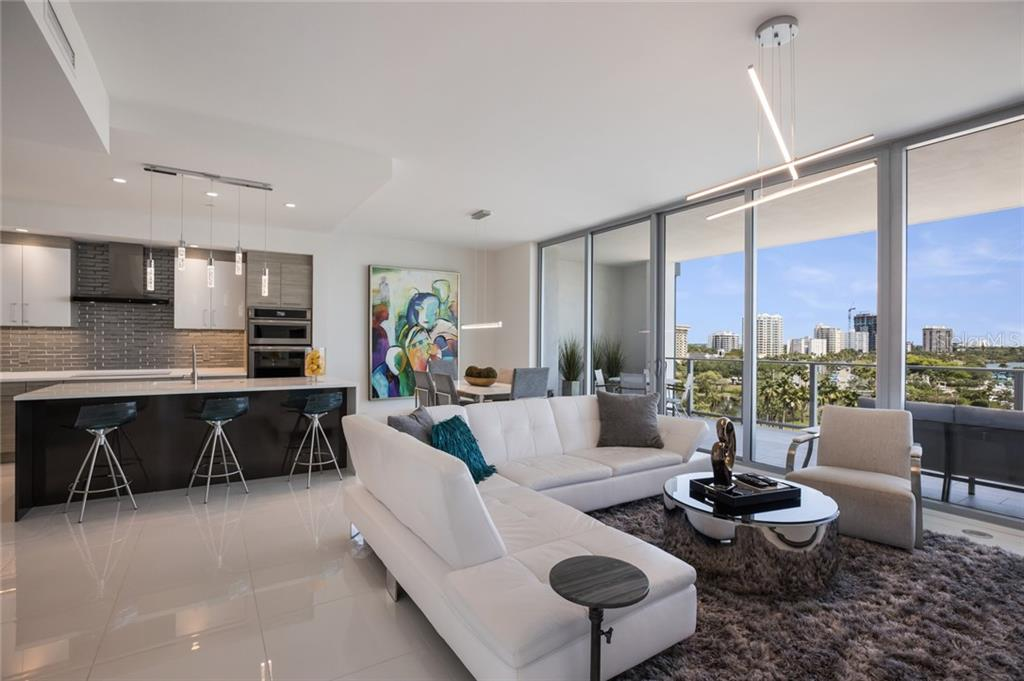 The open floor plan has an entire wall of glass sliding doors out to the oversized terrace. - Condo for sale at 1155 N Gulfstream Ave #708, Sarasota, FL 34236 - MLS Number is A4466759