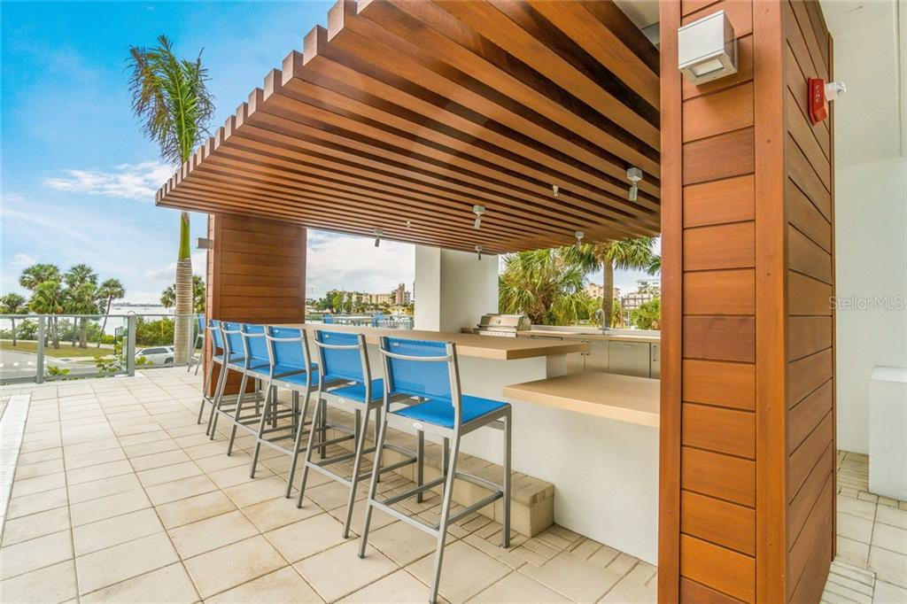 The poolside grilling cabana...who needs a vacation when you live here?!? - Condo for sale at 1155 N Gulfstream Ave #708, Sarasota, FL 34236 - MLS Number is A4466759