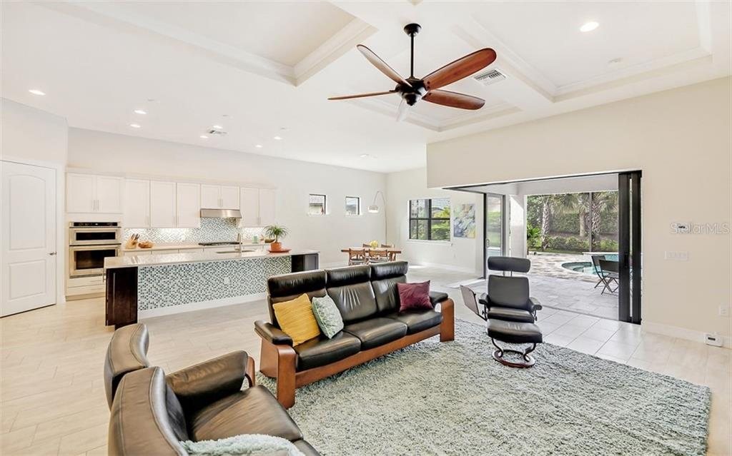 Bright, open great room plan, 11' ceilings. - Single Family Home for sale at 11057 Sandhill Preserve Dr, Sarasota, FL 34238 - MLS Number is A4469925