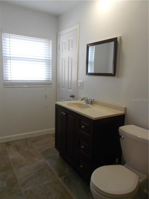 Master Bath - Door leads to Master Suite.  Mirror is a medicine cabinet. - Single Family Home for sale at 5326 Colewood Pl, Sarasota, FL 34232 - MLS Number is A4471495