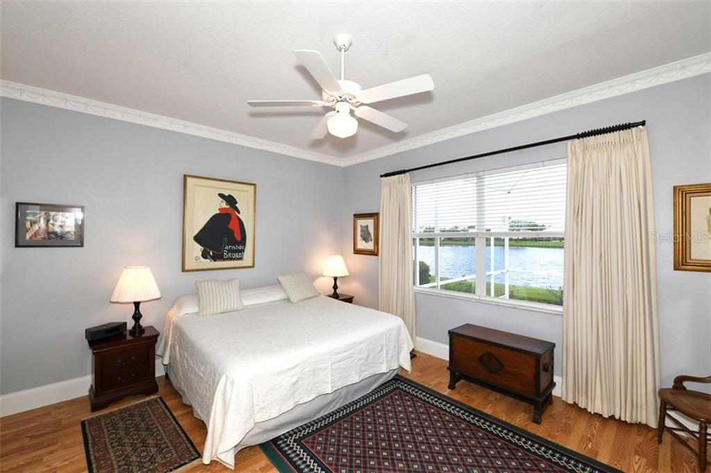 Master bedroom, wood flooring, en-suite. - Villa for sale at 4590 Samoset Dr, Sarasota, FL 34241 - MLS Number is A4471881