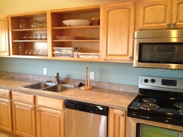Clubhouse kitchen. - Condo for sale at 977 Sandpiper Cir #977, Bradenton, FL 34209 - MLS Number is A4474554