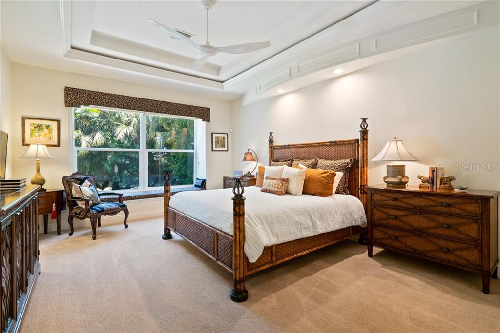 Master Bedroom with 2 walk in closets and access to the outdoor pool area - Single Family Home for sale at 1907 Clematis St, Sarasota, FL 34239 - MLS Number is A4474600