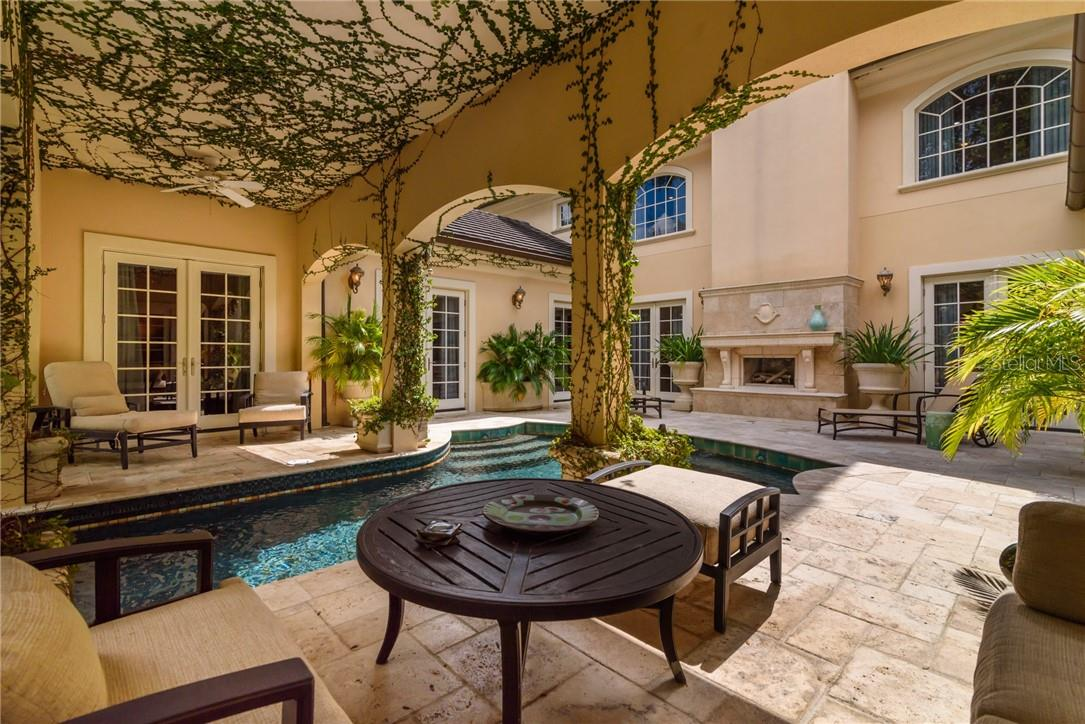 There is no other Mediterranean pool scape like this one in Sarasota County! Dream of cool waters during the summer months here, and then a glass or brandy next to the toasty fireplace on cool nights! - Single Family Home for sale at 1807 Oleander St, Sarasota, FL 34239 - MLS Number is A4475067