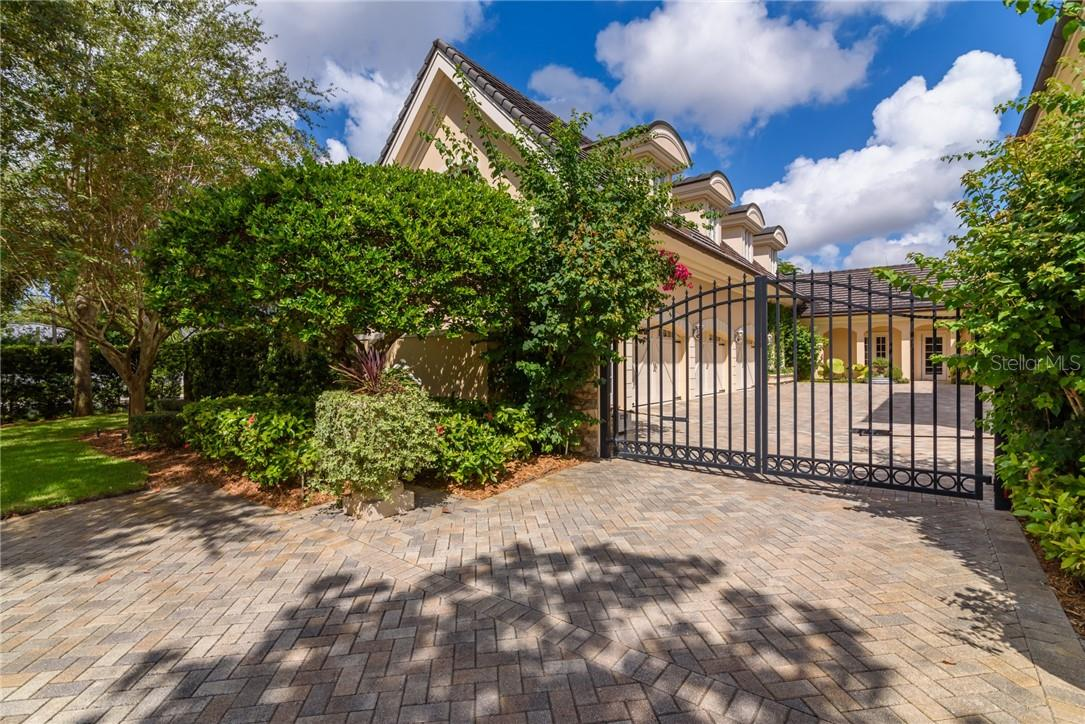 Brick pavered driveway and remote controlled gate allows access to the walled, gated motor court of the home. - Single Family Home for sale at 1807 Oleander St, Sarasota, FL 34239 - MLS Number is A4475067