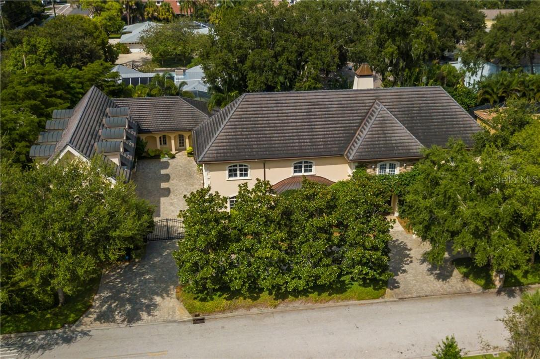 Property is located on 3 lots of almost 1/2 acre in desirable west of Trail neighborhood. Home features Hansen interlocking 50 year tile roof. - Single Family Home for sale at 1807 Oleander St, Sarasota, FL 34239 - MLS Number is A4475067