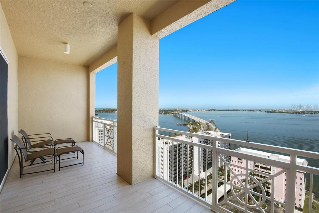 Master Suite entry with Tiger Eye Maple Cabinet beverage center and storage - Condo for sale at 35 Watergate Dr #1803, Sarasota, FL 34236 - MLS Number is A4476458