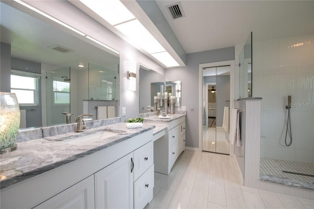 Master Bathroom - Single Family Home for sale at 5628 Country Lakes Dr E, Sarasota, FL 34243 - MLS Number is A4477442